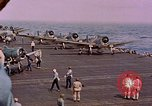 Image of F6Fs and SBD Douglas Dauntless on flight deck of USS Lexington Pacific Ocean, 1944, second 56 stock footage video 65675071278