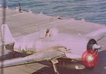 Image of F6Fs and SBD Douglas Dauntless on flight deck of USS Lexington Pacific Ocean, 1944, second 57 stock footage video 65675071278