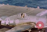 Image of F6Fs and SBD Douglas Dauntless on flight deck of USS Lexington Pacific Ocean, 1944, second 58 stock footage video 65675071278