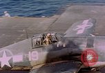 Image of F6Fs and SBD Douglas Dauntless on flight deck of USS Lexington Pacific Ocean, 1944, second 59 stock footage video 65675071278
