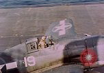 Image of F6Fs and SBD Douglas Dauntless on flight deck of USS Lexington Pacific Ocean, 1944, second 60 stock footage video 65675071278
