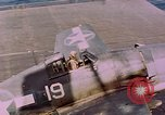 Image of F6Fs and SBD Douglas Dauntless on flight deck of USS Lexington Pacific Ocean, 1944, second 61 stock footage video 65675071278