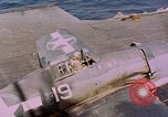 Image of F6Fs and SBD Douglas Dauntless on flight deck of USS Lexington Pacific Ocean, 1944, second 62 stock footage video 65675071278