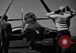 Image of aircraft carrier and Grumman F9 jets United States USA, 1953, second 31 stock footage video 65675071362
