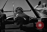 Image of aircraft carrier and Grumman F9 jets United States USA, 1953, second 32 stock footage video 65675071362