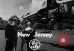 Image of Marilyn Rich stunt on rings New York City USA, 1951, second 1 stock footage video 65675071433