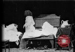 Image of Girls in white night dresses having a pillow fight United States USA, 1893, second 2 stock footage video 65675071525