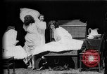 Image of Girls in white night dresses having a pillow fight United States USA, 1893, second 3 stock footage video 65675071525