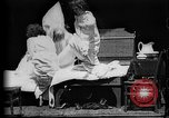 Image of Girls in white night dresses having a pillow fight United States USA, 1893, second 4 stock footage video 65675071525