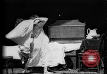Image of Girls in white night dresses having a pillow fight United States USA, 1893, second 5 stock footage video 65675071525