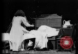 Image of Girls in white night dresses having a pillow fight United States USA, 1893, second 14 stock footage video 65675071525