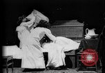 Image of Girls in white night dresses having a pillow fight United States USA, 1893, second 15 stock footage video 65675071525