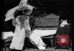Image of Girls in white night dresses having a pillow fight United States USA, 1893, second 16 stock footage video 65675071525