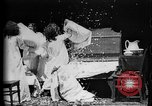 Image of Girls in white night dresses having a pillow fight United States USA, 1893, second 21 stock footage video 65675071525