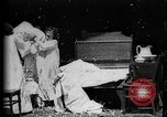 Image of Girls in white night dresses having a pillow fight United States USA, 1893, second 25 stock footage video 65675071525