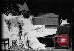 Image of Girls in white night dresses having a pillow fight United States USA, 1893, second 26 stock footage video 65675071525