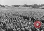 Image of Adolf Hitler in Nazi rally at Zeppelin Field in Nuremberg Germany, 1933, second 2 stock footage video 65675071551