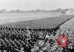 Image of Adolf Hitler at rally with German Storm troopers Germany, 1933, second 1 stock footage video 65675071554
