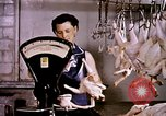 Image of harvesting chickens fruits and vegatables United States USA, 1956, second 5 stock footage video 65675071652