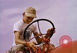 Image of harvesting chickens fruits and vegatables United States USA, 1956, second 29 stock footage video 65675071652