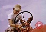 Image of harvesting chickens fruits and vegatables United States USA, 1956, second 32 stock footage video 65675071652