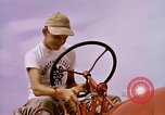 Image of harvesting chickens fruits and vegatables United States USA, 1956, second 33 stock footage video 65675071652