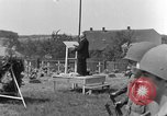 Image of burial service Germany, 1945, second 50 stock footage video 65675071658
