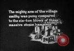 Image of Steam driven hammer forges hot steel billets into Studebaker engine parts South Bend Indiana USA, 1920, second 1 stock footage video 65675071728