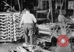 Image of Assembling engines in an Studebaker automobile plant South Bend Indiana USA, 1920, second 8 stock footage video 65675071729