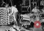 Image of Assembling engines in an Studebaker automobile plant South Bend Indiana USA, 1920, second 10 stock footage video 65675071729