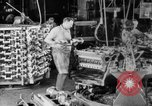 Image of Assembling engines in an Studebaker automobile plant South Bend Indiana USA, 1920, second 12 stock footage video 65675071729