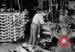 Image of Assembling engines in an Studebaker automobile plant South Bend Indiana USA, 1920, second 13 stock footage video 65675071729