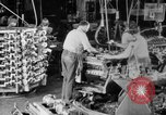 Image of Assembling engines in an Studebaker automobile plant South Bend Indiana USA, 1920, second 15 stock footage video 65675071729