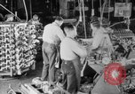 Image of Assembling engines in an Studebaker automobile plant South Bend Indiana USA, 1920, second 17 stock footage video 65675071729
