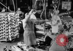 Image of Assembling engines in an Studebaker automobile plant South Bend Indiana USA, 1920, second 20 stock footage video 65675071729