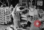 Image of Assembling engines in an Studebaker automobile plant South Bend Indiana USA, 1920, second 21 stock footage video 65675071729