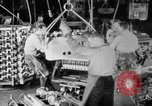 Image of Assembling engines in an Studebaker automobile plant South Bend Indiana USA, 1920, second 23 stock footage video 65675071729