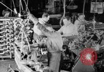 Image of Assembling engines in an Studebaker automobile plant South Bend Indiana USA, 1920, second 25 stock footage video 65675071729