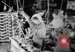 Image of Assembling engines in an Studebaker automobile plant South Bend Indiana USA, 1920, second 26 stock footage video 65675071729