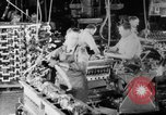 Image of Assembling engines in an Studebaker automobile plant South Bend Indiana USA, 1920, second 27 stock footage video 65675071729