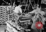 Image of Assembling engines in an Studebaker automobile plant South Bend Indiana USA, 1920, second 29 stock footage video 65675071729