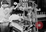 Image of Assembling engines in an Studebaker automobile plant South Bend Indiana USA, 1920, second 30 stock footage video 65675071729