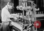 Image of Assembling engines in an Studebaker automobile plant South Bend Indiana USA, 1920, second 31 stock footage video 65675071729