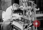 Image of Assembling engines in an Studebaker automobile plant South Bend Indiana USA, 1920, second 32 stock footage video 65675071729