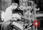 Image of Assembling engines in an Studebaker automobile plant South Bend Indiana USA, 1920, second 33 stock footage video 65675071729