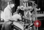 Image of Assembling engines in an Studebaker automobile plant South Bend Indiana USA, 1920, second 34 stock footage video 65675071729