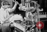 Image of Assembling engines in an Studebaker automobile plant South Bend Indiana USA, 1920, second 35 stock footage video 65675071729