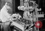 Image of Assembling engines in an Studebaker automobile plant South Bend Indiana USA, 1920, second 36 stock footage video 65675071729