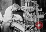Image of Assembling engines in an Studebaker automobile plant South Bend Indiana USA, 1920, second 37 stock footage video 65675071729