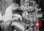 Image of Assembling engines in an Studebaker automobile plant South Bend Indiana USA, 1920, second 38 stock footage video 65675071729